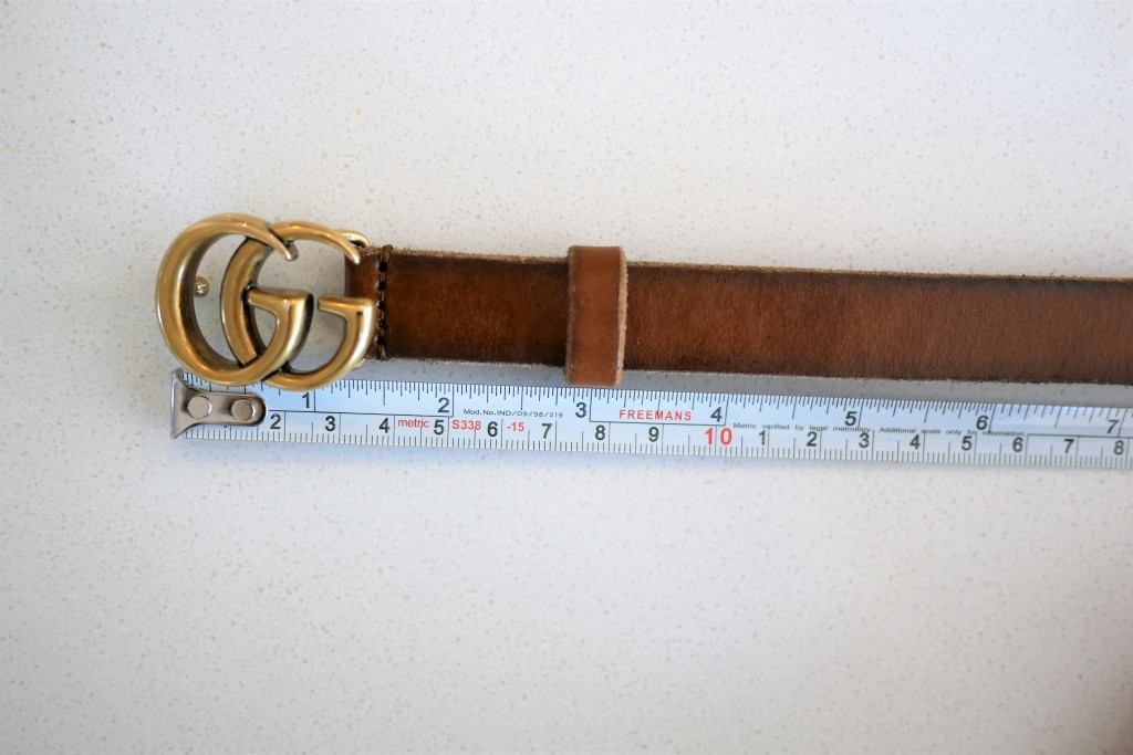 Measuring the length of the Gucci belt